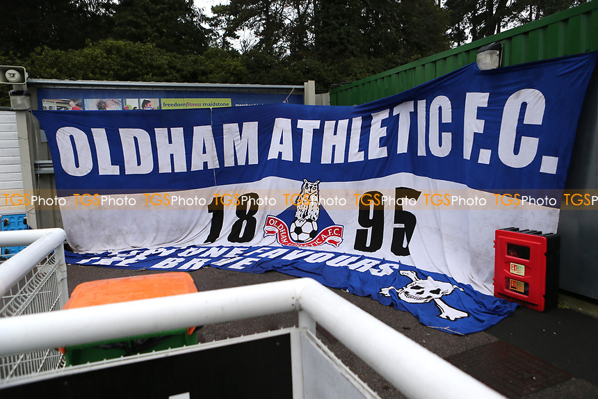 Oldham fans display their flag in the corner of the ground during Maidstone United vs Oldham Athletic, Emirates FA Cup Football at the Gallagher Stadium on 1st December 2018