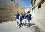 Syrian refugee children walk to school in Madaba, a sprawling Palestinian refugee camp in Jordan that has grown in recent years with the arrival of refugees from war-torn Syria. As a result, the more than 25,000 Palestinians in Madaba have been joined by more than 6,000 Syrians. The  Department of Service for Palestinian Refugees of the Middle East Council of Churches, a member of the ACT Alliance, provides a variety of services here, including medical care.<br /> <br /> Parental consent obtained.