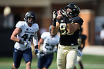 Cam Serigne (85) of the Wake Forest Demon Deacons hauls in a 45-yard touchdown pass during first quarter action against the Utah State Aggies at BB&T Field on September 16, 2017 in Winston-Salem, North Carolina.  (Brian Westerholt/Sports On Film)