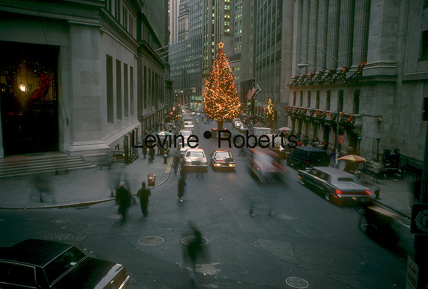 The New York Stock Exchange Christmas tree on Broad Street is seen in December 1986. Prior to September 11 traffic was permitted on Broad Street as well as parking. (© Richard B. Levine)