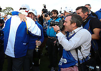 Thomas Bjorn (EUR) and Rory McIlroy (EUR) embrace on the last hole during Sunday's Singles at the 2014 Ryder Cup from Gleneagles, Perthshire, Scotland. Picture:  David Lloyd / www.golffile.ie