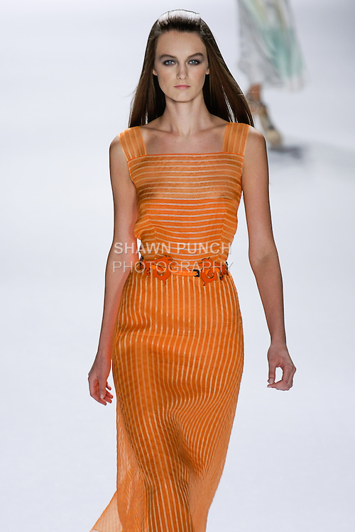Andie walks runway in an outfit from the Carolina Herrera Spring 2013 Timeless Influence collection, during Mercedes-Benz Fashion Week Spring 2013 in New York City.