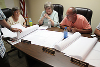 MEGAN DAVIS/MCDONALD COUNTY PRESS Council members reviewed maps of Southwest City's water system and discussed the best course of action for replacing the outdated lines.