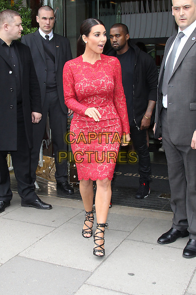 Kim Kardashian & Kanye West.Leaving their hotel, London, England..March 18th, 2012.full length red pink lace dress strappy black sandals couple mouth open.CAP/HIL.©John Hillcoat/Capital Pictures.