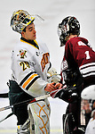 22 November 2011: University of Vermont Catamount goaltender Rob Madore, a Senior from Pittsburgh, PA, shakes hands with his counterpart goaltender, Jeff Teglia, of the University of Massachusetts Minutemen at Gutterson Fieldhouse in Burlington, Vermont. The Catamounts defeated the Minutemen 2-1 in their annual pre-Thanksgiving meeting in the Hockey East season. Mandatory Credit: Ed Wolfstein Photo