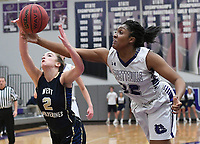 NWA Democrat-Gazette/J.T. WAMPLER Fayetteville's Jasmine Franklin and Bentonville West's Allie Clifton chase a rebound Wednesday Feb. 7, 2018 at Bulldog Arena in Fayetteville. The Lady Bulldogs won 64-46.
