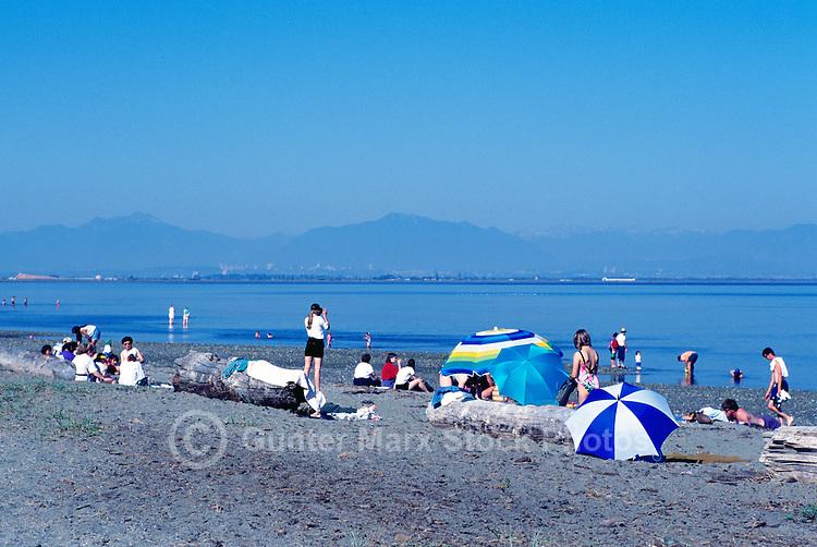 Summer Recreational Activities along Pacific Ocean, Boundary Bay Regional Park, Delta, BC, British Columbia, Canada - People sunbathing on Sandy Beach