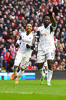 Sunday, 23 February 2014<br /> Pictured: Swansea City's Wilfried Bony celebrates scoring a penalty to make the score 3-3.<br /> Re: Barclay's Premier League, Liverpool FC v Swansea City FC v at Anfield Stadium, Liverpool Merseyside, UK.