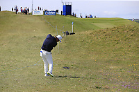Hideto Tanihara (JPN) plays his 2nd shot on the 1st hole during Thursday's Round 1 of the Dubai Duty Free Irish Open 2019, held at Lahinch Golf Club, Lahinch, Ireland. 4th July 2019.<br /> Picture: Eoin Clarke | Golffile<br /> <br /> <br /> All photos usage must carry mandatory copyright credit (© Golffile | Eoin Clarke)