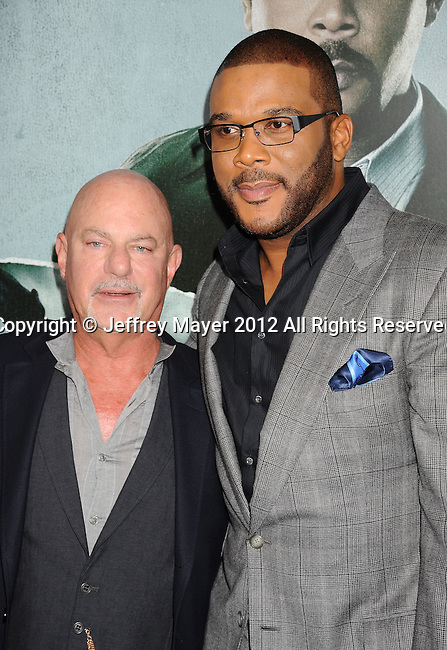 HOLLYWOOD, CA - OCTOBER 15: Rob Cohen and Tyler Perry arrive at the Los Angeles premiere of 'Alex Cross' at the ArcLight Cinemas Cinerama Dome on October 15, 2012 in Hollywood, California.