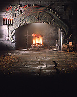 St Georges Castle with suckling pig roasting over open fire & Dragon above