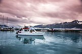 USA, Alaska, Seward, a boat heading out of the Seward harbor and marina
