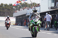 Federico Sandi (ITA) riding the Kawasaki ZX-10R (23) of the Pedercini Team leaving the pits for a practise session on day one of round one of the 2013 FIM World Superbike Championship at Phillip Island, Australia.