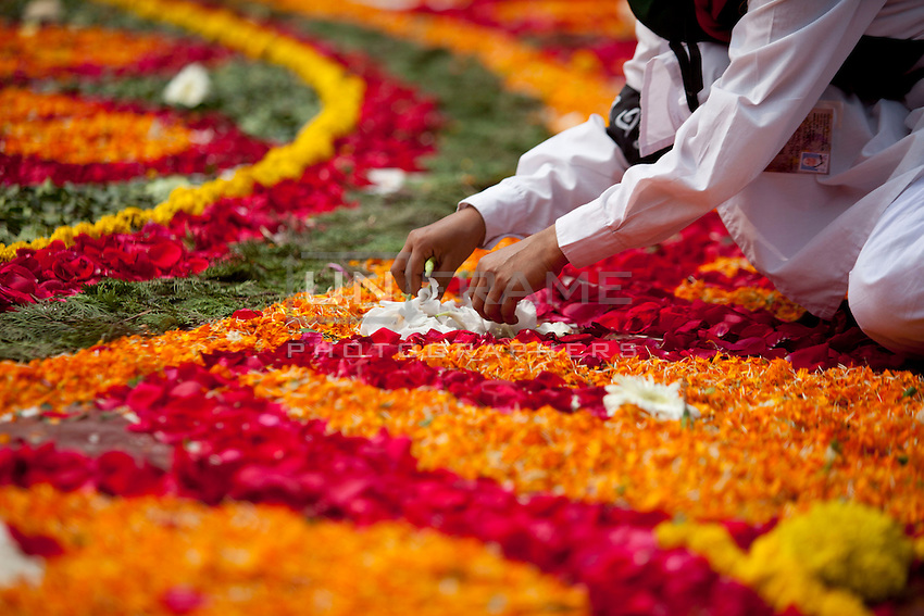 A Bangladeshi girl decorates the Dhaka Central Shaheed Minar, or Martyr's Monuments on International Mother Language Day in Dhaka, Bangladesh, Saterday, Feb. 21, 2015. International Mother Language Day is observed in commemoration of the movement where a number of students died in 1952, defending the recognition of Bangla as a state language of the former East Pakistan, now Bangladesh. The day is now observed across the world to promote linguistic and cultural diversity and multilingualism.