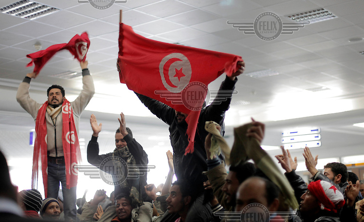 Jubilant Egyptians are excited to fly fro Djerba, Tunisia, waiving Tunsian flags. Aircraft from many countries were mobilized to fly Egyptian refugees back to Egypt. Tens of thousands of people, mainly migrant workers, fled unrest in Libya and crossed the border into Tunisia. Some slept in the open for several days before being processed.  At the same time forces loyal to Col. Gaddafi fought opposition forces in various parts of the country.