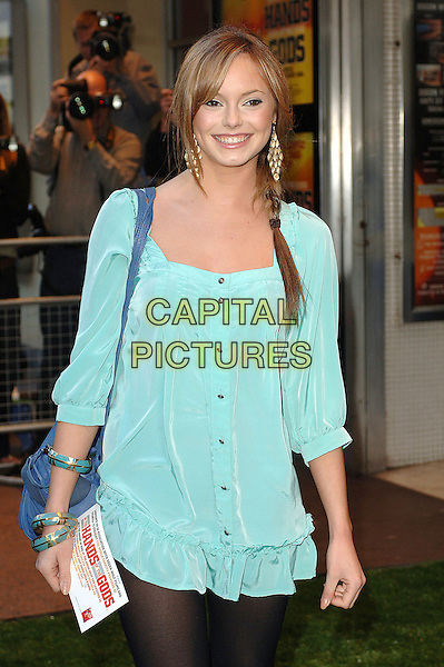 "HANNAH TOINTON.Attending the World Charity Premiere of ""In The Hands Of The Gods"", Odeon West End, London, England..September 10th, 2007.half length gold earrings hanna plait hair braid green shirt dress tunic top blue bag.CAP/ BEL.©Tom Belcher/Capital Pictures."