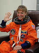 FILE: In this photo released by NASA, STS-121 crew members, including Mission Specialist Lisa Nowak, are happy to be making a third launch attempt on July 4, 2006. Nowak suits up in the Operations and Checkout building at NASA's Kennedy Space Center in Florida before heading to Launch Pad 39B. <br /> Mandatory Credit: Kim Shiflett - NASA via CNP