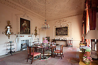 The pink dining room, its ceiling decorated with intricately worked stucco foliage