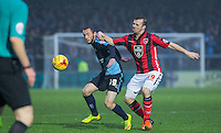 Michael Harriman of Wycombe Wanderers holds off Laurence Wilson of Morecambe during the Sky Bet League 2 match between Wycombe Wanderers and Morecambe at Adams Park, High Wycombe, England on 2 January 2016. Photo by Andy Rowland / PRiME Media Images