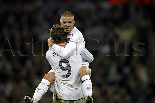 21 November 2007: England substitute David Beckham celebrates with Peter Crouch after Crouch scores to make the score 2-2 during the European Championships qualifier between England and Croatia played at Wembley. Croatia won the game 3-2. Photo: Glyn Kirk/Actionplus....071121 football soccer player joy celebration