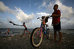 Belize - SEPTEMBER 14, 2007: boys play along the waterfront in Punta Gorda on September 14, 2007 in Belize.  (PHOTOGRAPH BY MICHAEL NAGLE)