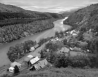 """""""Telegraph Creek on the Stikine River"""" <br /> British Columbia, Canada<br /> <br /> The small community of Telegraph Creek is located on the Stikine River in northwest British Columbia, Canada. The community is accessible via Telegraph Creek Road, a challenging drive with steep grades that are best negotiated in dry weather. This photo shows the town and its close connection to the river."""