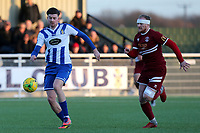 George Sykes of Aveley and Robbie Simpson of Chelmsford City during Aveley vs Chelmsford City, Buildbase FA Trophy Football at Parkside on 8th February 2020