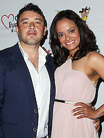 WESTWOOD, LOS ANGELES, CA, USA - JUNE 21: George Valencia, Judy Reyes at the Los Angeles Premiere Of 'La Golda' held at The Crest on June 21, 2014 in Westwood, Los Angeles, California, United States. (Photo by Celebrity Monitor)