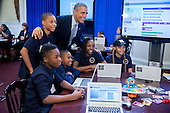 """United States President Barack Obama has his photo taken with middle-school students who are participating in an """"Hour of Code"""" event in the Eisenhower Executive Office Building next to the White House in Washington, D.C., U.S., on Monday, December 8, 2014. The event is in honor of Computer Science Education Week. <br /> Credit: Andrew Harrer / Pool via CNP"""