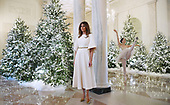 First Lady Melania Trump looks at a performance in the Grand Foyer of the White House in Washington, DC, as she also participates in arts and crafts projects with children and students from Joint Base Andrews on November 27, 2017.<br /> Credit: Olivier Douliery / Pool via CNP