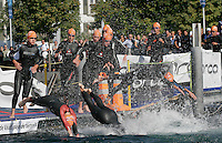 03 SEP 2006 - LAUSANNE, SWITZERLAND - Elite Women competitors dive back into Lac Leman for their second swim lap during the World Triathlon Championships. (PHOTO (C) NIGEL FARROW)
