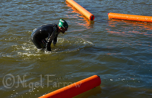 01 JUN 2013 - MADRID, ESP - A competitor leaves the water at the end of his WTP Agemaster wave swim in Casa de Campo in Madrid, Spain (PHOTO (C) 2013 NIGEL FARROW)
