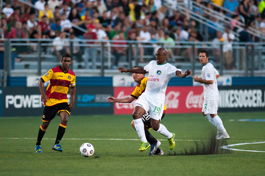 HEMPSTEAD, NY – AUGUST 3: Marcos Senna of the New York Cosmos battles for the ball during the Cosmo's home opener against the Fort Lauderdale Strikers on August 3, 2013 at Hofstra University's Shuart Stadium in Hempstead, New York.