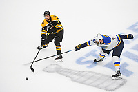 June 6, 2019: St. Louis Blues left wing Pat Maroon (7) tries to check the stick of Boston Bruins defenseman Connor Clifton (75) during game 5 of the NHL Stanley Cup Finals between the St Louis Blues and the Boston Bruins held at TD Garden, in Boston, Mass. The Blues defeat the Bruins 2-1 in regulation time. Eric Canha/CSM