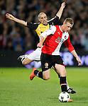 Nederland, Rotterdam, 31 maart 2012.Eredivisie.Seizoen 2011-2012.Feyenoord-NAC Breda.John Guidetti (r.) van Feyenoord en Anthony Lurling (l.) van NAC Breda strijden om de bal