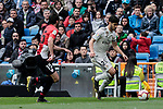 Real Madrid's Marco Asensio and Athletic Club de Bilbao's Inigo Lekue during La Liga match between Real Madrid and Athletic Club de Bilbao at Santiago Bernabeu Stadium in Madrid, Spain. April 21, 2019. (ALTERPHOTOS/A. Perez Meca)