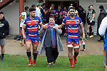 As part of their Mothers Day tribute Ardmore Marist players, Karl and Savelio Ropati were accompanied by their mother as they came out for the Counties Manukau Premier Club Rugby game between Ardmore Marist and Manurewa, played at Bruce Pulman Park Papakura on Saturday May 12th 2018. Ardmore Marist won the game 20 - 3 after leading 17 - 3 at halftime.<br /> Ardmore Marist - Katetistoti Nginingini try, penalty try, Latiume Fosita conversion, Latiume Fosita 2 penalties.<br /> Manurewa - Logan Fonoti penalty.<br /> Photo by Richard Spranger.