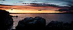 Beautiful dramatic panoramic sunset sky scenery of rocks on the Pacific ocean coast in Nanaimo, Vancouver Island, BC, Canada.