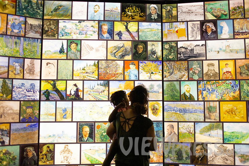 """LISBON, PORTUGAL - MAY 31: A visitor caries a child at the """"Meet VicentVanGogh"""" exhibition as the spread of the (COVID-19) continues in Lisbon, on May 31, 2020. <br /> Meet Vincent van Gogh is an interactive experience, to get to know Lisbon, through which it proposes to make Vincent's art accessible to as many people as possible.<br /> (Photo by Luis Boza/VIEWpress via Getty Images)"""
