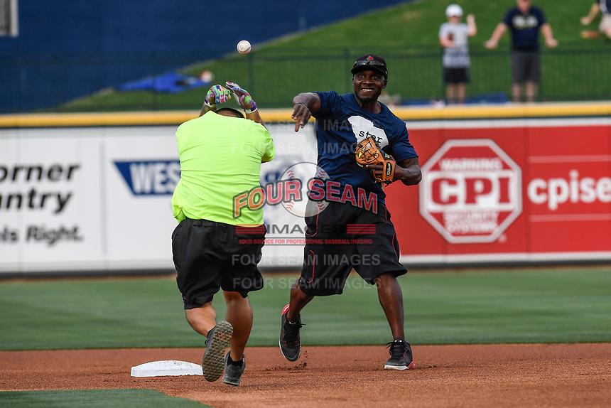 Former Major Leaguer and Spartanburg Methodist College star Orlando Hudson turns a double play at the Celebrities vs. Soldiers Softball Game as part of the South Atlantic League All-Star Game festivities on Monday, June 19, 2017, at Spirit Communications Park in Columbia, South Carolina. (Tom Priddy/Four Seam Images)