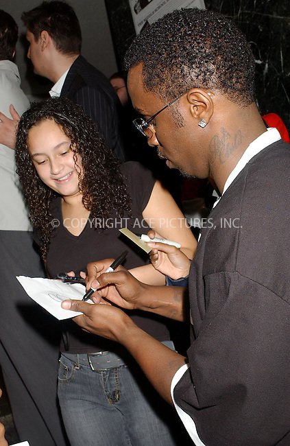 WWW.ACEPIXS.COM . . . . . ....NEW YORK, NOVEMBER 2, 2004....Sean 'P. Diddy' Combs shows off three of his tattoos on Election Day.....Please byline: DAISY STONE - ACE PICTURES.. . . . . . ..Ace Pictures, Inc:  ..Alecsey Boldeskul (646) 267-6913 ..Philip Vaughan (646) 769-0430..e-mail: info@acepixs.com..web: http://www.acepixs.com