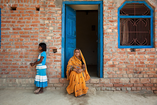 """25 APRIL 2012, Chak Padri Village, Rampur block, Jaunpur District, Uttar Pradesh, India..Geeta Jaiswal (45 years old) from Kasheru Bazar village, Rampur block is a beneficiary of the Financial Literacy for Financial Inclusion programme. .Says Geeta: """"I have three children but my husband has been sick with TB for 6 years. I would need to go to a money lender before to pay my husbands doctor bill. The Self Help Group taught me how to use money. Now with my savings I don't need a money lender and we can pay for my husbands illness. My kids can go to school and not work"""".Geeta works in the fields and her daughter provides for the family with a wage from UNDP..The UNDP/ IKEA Foundation are collaborating on long term projects in  Rampur block  to promote women's empowerment through Swaayam. Swaayam - meaning 'by oneself' - is a women's social ,economic political and legal empowerment project implemented since 2009 across 500 villages with the aim of giving women the power to transform their own lives and the lives of their children and communities. Picture by Graham Crouch/UNDP25 APRIL 2012, Chak Padri Village, Rampur block, Jaunpur District, Uttar Pradesh, India..Village women attending a Functional Literacy meeting  at Chak Padri village.The UNDP/ IKEA Foundation are collaborating on long term projects in  Rampur block  to promote women's empowerment through Swaayam. Swaayam - meaning 'by oneself' - is a women's social ,economic political and legal empowerment project implemented since 2009 across 500 villages with the aim of giving women the power to transform their own lives and the lives of their children and communities. Picture by Graham Crouch"""