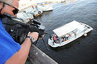 John Skovbo, from Denmark, takes part in a training course to fight maritime terror and piracy, on a boat in Haifa Port..