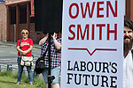© Joel Goodman - 07973 332324 . 30/07/2016 . Liverpool , UK . Jeremy Corbyn campaigner watches an Owen Smith rally in a field off Bridgewater Street in Liverpool after the booked venue , the Camp and Furnace warehouse , reportedly cancelled the booking . Smith is campaigning to replace Jeremy Corbyn as the leader of the Labour Party . Photo credit : Joel Goodman
