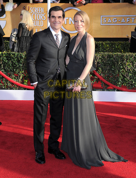 Ty Burrell & Holly Burrell.Arrivals at the 19th Annual Screen Actors Guild Awards at the Shrine Auditorium in Los Angeles, California, USA..27th January 2013.SAG SAGs full length halterneck dress clutch bag married husband wife black white grey gray suit tie shirt    .CAP/DVS.©DVS/Capital Pictures.