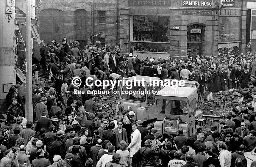 Scene outside the furniture store on the Shankill Road, Belfast, N Ireland, UK, following a no warning Provisional IRA bomb explosion, 11th December 1971, in which two children, Tracey Munn and Colin Nicholl, and two adults, Harold King and Hugh Bruce, died. The children were in a pram passing the store when the bomb exploded. For more information see Lost Lives entries 213, 214, 215 and 216. 197112110556<br />