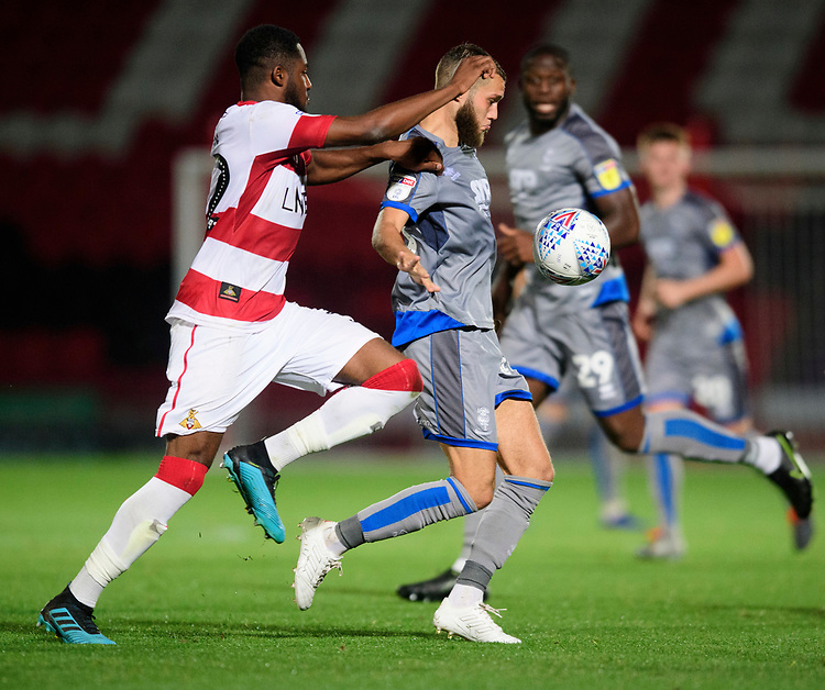 Lincoln City's Jorge Grant vies for possession with Doncaster Rovers' Cameron John<br /> <br /> Photographer Chris Vaughan/CameraSport<br /> <br /> EFL Leasing.com Trophy - Northern Section - Group H - Doncaster Rovers v Lincoln City - Tuesday 3rd September 2019 - Keepmoat Stadium - Doncaster<br />  <br /> World Copyright © 2018 CameraSport. All rights reserved. 43 Linden Ave. Countesthorpe. Leicester. England. LE8 5PG - Tel: +44 (0) 116 277 4147 - admin@camerasport.com - www.camerasport.com
