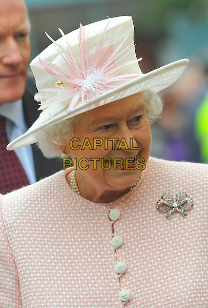 HM THE QUEEN, Elizabeth II (2nd) .HM THE QUEEN, Elizabeth II (2nd) & HRH PRINCE PHILIP, Duke of Edinburgh Royal Visit to Margate, Kent, England..November 11th, 2011.royals royalty headshot portrait lipstick on teeth pink hat coat  brooch .CAP/CAS.©Bob Cass/Capital Pictures.