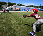 WATERBURY, CT, CT - 21 JULY - 072118JW01.jpg -- Brayden Gaudiosi age 7 fields a throw from former Chicago Cubs player Angel Echevarria Saturday morning at Municipal Stadium during the Family & Children's Aid and the MLB Alumni Association baseball clinic series for kids ages 6-16. Jonathan Wilcox Republican-American