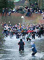 09/02/16 today photo - not as in previous incorrect caption.<br /> <br /> Players chase the ball through Henmore Brook as the Royal Shrovetide football match is played through the town of Ashbourne, Derbyshire. U'rads and Down'ards attempt to goal the ball on stone goals set three miles apart in the Peak District town.<br /> <br /> <br /> All Rights Reserved: F Stop Press Ltd. +44(0)1335 418365   +44 (0)7765 242650 www.fstoppress.com
